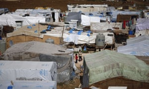 Syrian children stand outside tents at a refugee camp in the town of Hosh Hareem, in east Lebanon's Bekaa Valley