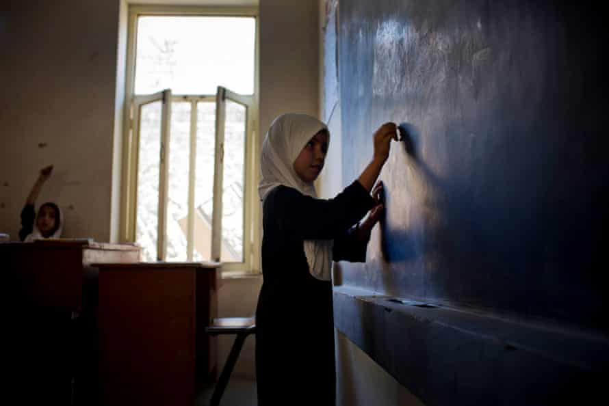 A pupil writes on a blackboard at the Malalai high school for girls, many of whom are reportedly setting their sights on higher education.