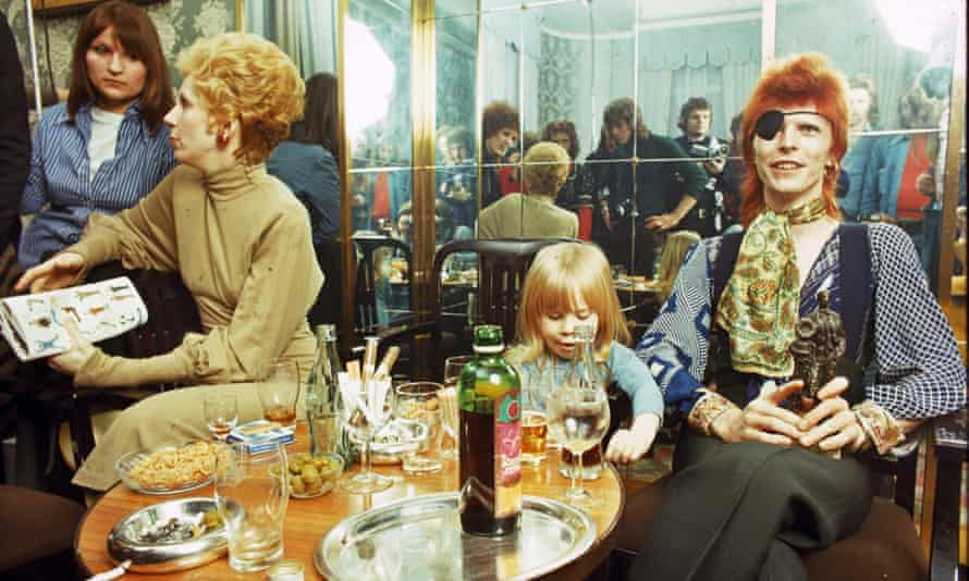 Angie Bowie, Zowie Bowie (now Duncan Jones) and David Bowie in Amsterdam, 1974.