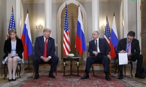 Helsinki, Finland. Translators take notes and the Russian president, Vladimir Putin, looks on as the US president, Donald Trump, gives a statement at the beginning of a meeting between the two leaders