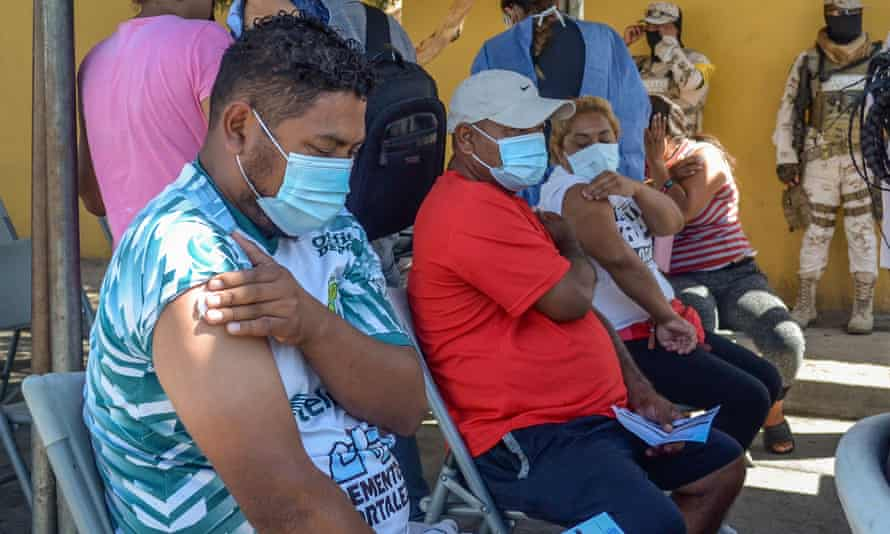 Migrants camping in the Mexican city of Tijuana receive COVID-19 vaccine