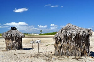 His and hers oilets made of  palm leaves in Jericoacoara, Brazil