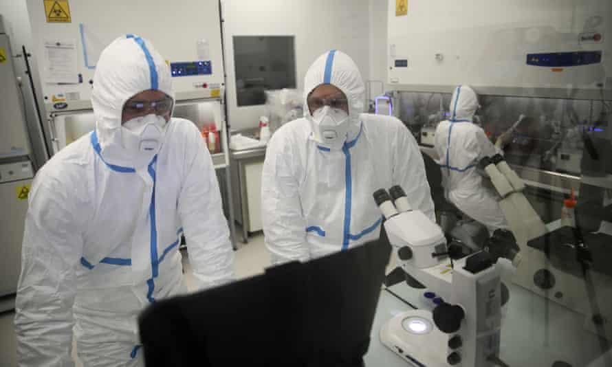 Laboratory technicians work at the Valneva headquarters in Saint-Herblain, western France.