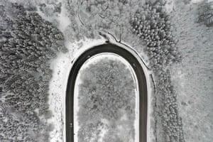 Meinerzhagen, Germany – Cars drive in a snow-covered landscape on the Nordhelle mountain near Meinerzhagen.