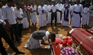 A mass burial of victims at a cemetery near St Sebastian church in Negombo, Sri Lanka