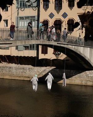 Three dummies entitled 'Democracy', 'Right to protest' and 'Freedom' hang from a bridge in Girona, Catalonia on 2 November. Division over the Catalan independence issue has impacted the political landscape across Spain.
