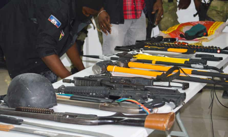 Seized guns are displayed at a press conference in Port-au-Prince on Thursday night.
