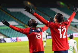 Jonathan Ikone (L) of Lille celebrates with teammate Yusuf Yazici.