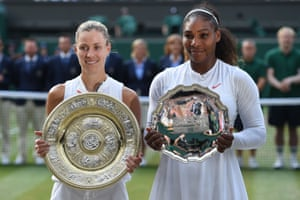 Angelique Kerber, left, holds the winner's trophy, the Venus Rosewater Dish, after her women's singles final victory over Serena Williams, who holds the runner's up plate.