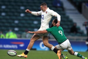England's Jonny May (left) kicks the ball past Ireland's Jamison Gibson-Park before scoring his side's second try.