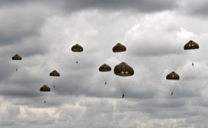Paratroopers from Britain's 16 Air Assault Brigade and France's 11th Parachute Brigade perform a jump over Sannerville, north-western France, on June 5, 2019.