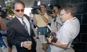 Andrew Weissmann wades through the media, during proceedings against Enron CEO Kenneth Lay in Houston in 2004.