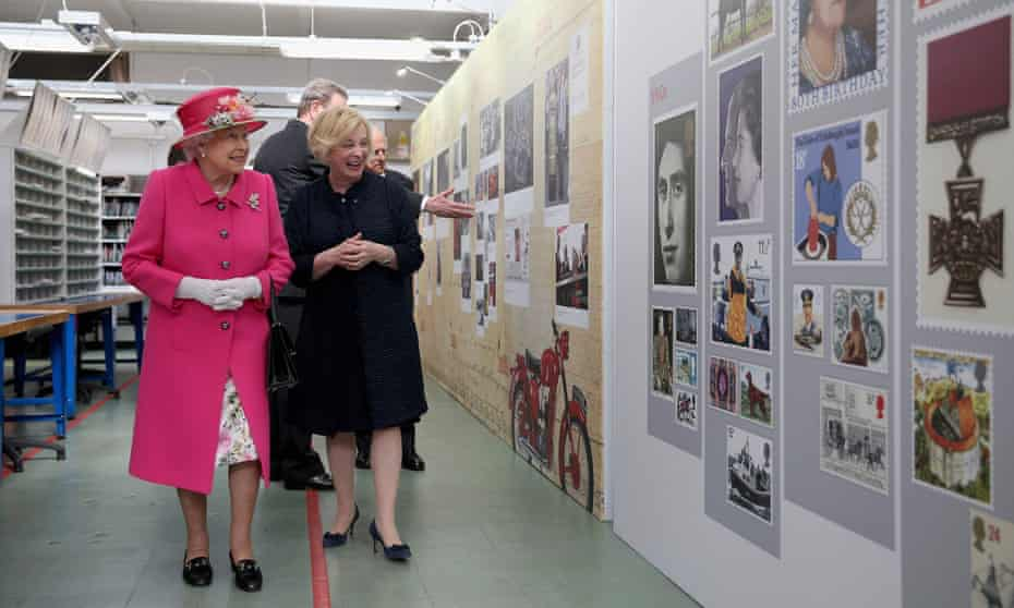 Moya Greene, who has received a £900,000 termination bonus, shows the Queen around the Royal Mail delivery office in Windsor.