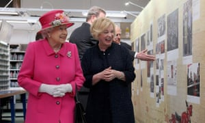 Queen Elizabeth II with Moya Greene touring the Royal Mail Windsor postal delivery office
