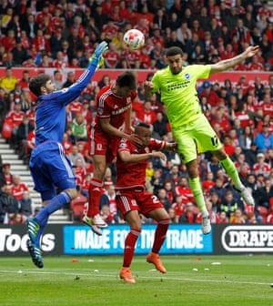 Brighton's Connor Goldson can't get his head to the ball as Middlesbrough keeper Dimitrios Konstantopoulos collects.