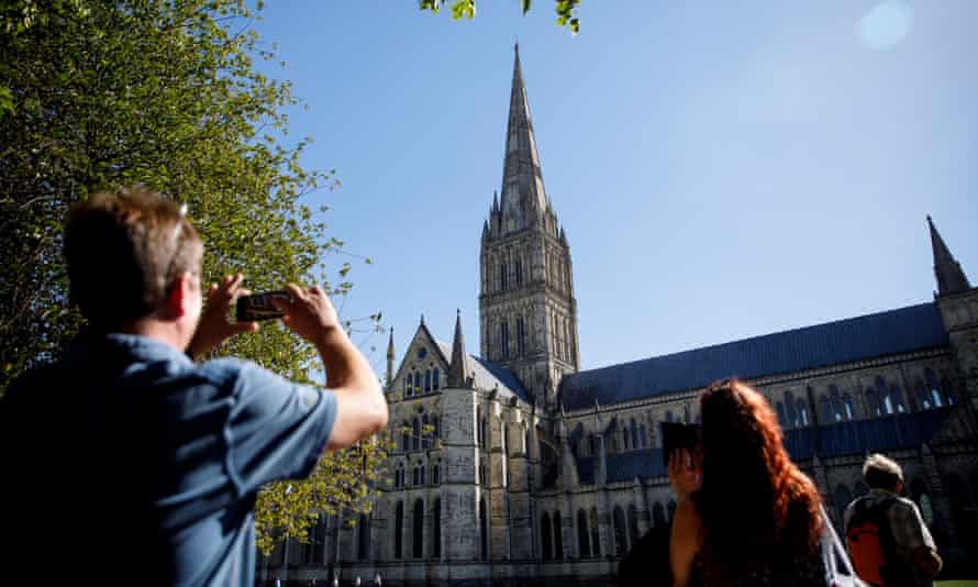 People take photos of Salisbury Cathedral