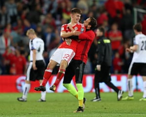 Wales' winning goalscorer Ben Woodburn is congratulated by team-mate Danny Ward after the final whistle.