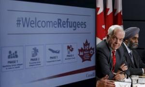 John McCallum, left, announces the refugee resettlement program alongside the defence minister, Harjit Sajjan, in Ottawa on 24 November 2015.
