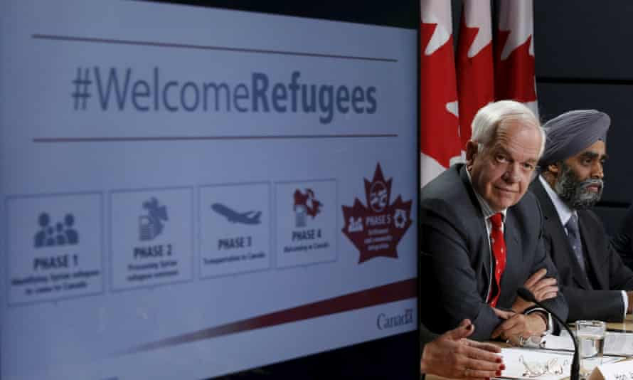 Canada's immigration minister, John McCallum, left, and defence minister, Harjit Sajjan, announce the refugee resettlement plan in Ottawa on Tuesday.
