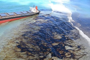 Oil drifts ashore after the MV Wakashio, a Japanese-owned, Panama-flagged bulk carrier ship, ran aground off the south-east coast of Mauritius