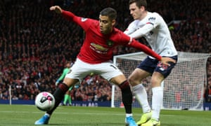 Andreas Pereira, the Belgium-born Brazil international who joined United when he was 16, tries to escape the clutches of Andy Robertson of Liverpool.
