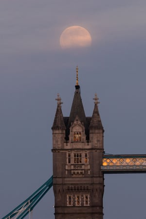 The pink supermoon rises above Tower Bridge in London, England.