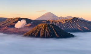 Volcano and other mountains rising from mist