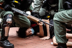 Pro-democracy protesters are arrested by police in the Causeway Bay district of Hong Kong on May 24, 2020, ahead of planned protests against a proposal to enact new security legislation in Hong Kong. - The proposed legislation is expected to ban treason, subversion and sedition, and follows repeated warnings from Beijing that it will no longer tolerate dissent in Hong Kong, which was shaken by months of massive, sometimes violent anti-government protests last year.