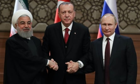 The presidents of Iran, Turkey and Russia shake hands.