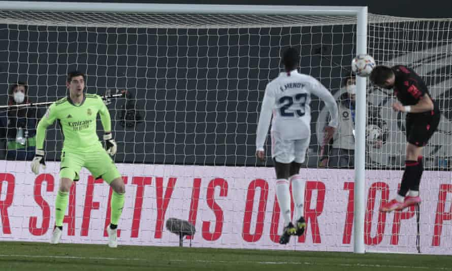 Portu (right) rises above Ferland Mendy to give Real Sociedad the lead in Madrid.