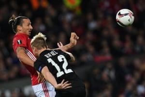 Zlatan Ibrahimovic beats Rafael Forster in the air.