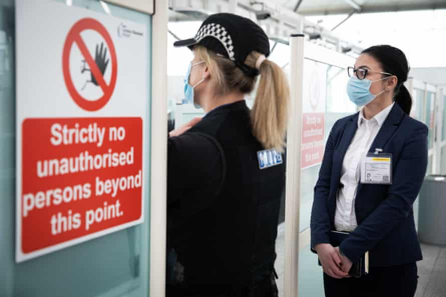 Cristina Huddleston, a director of the charity Justice and Care, at a London airport during a police operation to identify victims of human trafficking and slavery.