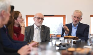 Jeremy Corbyn during a visit to discuss cuts to bus services with community members in Ilkeston, Derbyshire.