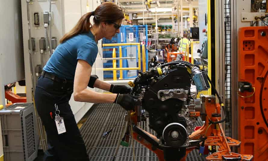 An employee at work on an engine production line at Ford's factory in Dagenham, London.