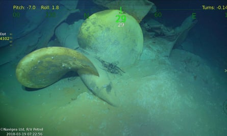 An underwater video image shows a propeller, part of wreckage from the USS Juneau.