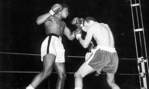 Cassius Clay (later Muhammad Ali) fights Henry Cooper at Wembley Stadium on 18 June 1963