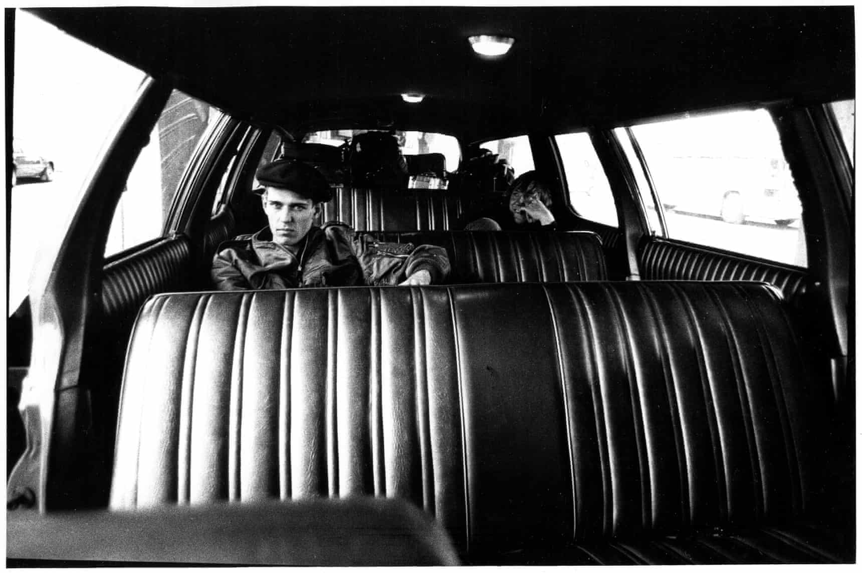 An image of Paul Simonon in the back of a car
