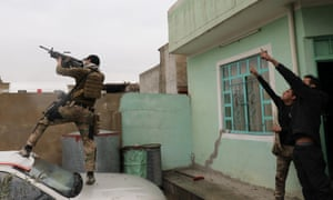 An Iraqi special forces soldier fires at a drone operated by Islamic State militants in Mosul.