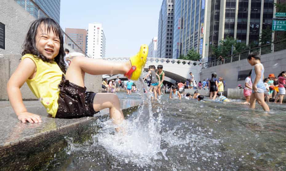 A girl plays in the waters of the Cheonggyecheon Stream in downtown Seoul.