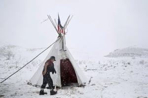 Vietnam veteran Allen Coomsta Matt walks into his teepee at the Oceti Sakowin camp.