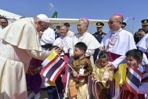 Francis was greeted by children in traditional costume