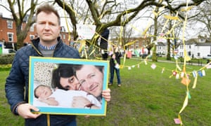 Richard Ratcliffe holds a photograph of himself with his wife, Nazanin, and daughter, Gabriella.