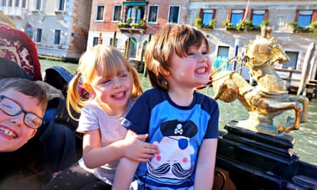 Emma Harris's children (from left) Oli, Charlotte and Dylan, on a gondola ride in Venice.