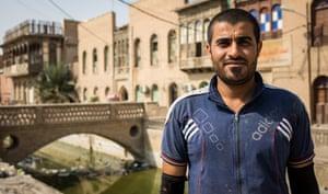 Carpenter Habib outside his Basra workshop
