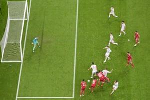 Iran's Saeid Ezatolahi, no 6, strays offside before rifling the ball into the net.