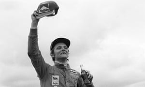 Niki Lauda celebrates winning the Spanish Grand Prix after mastering difficult, slippery conditions.