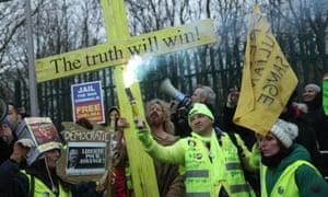 Demonstrators outside Woolwich crown court.