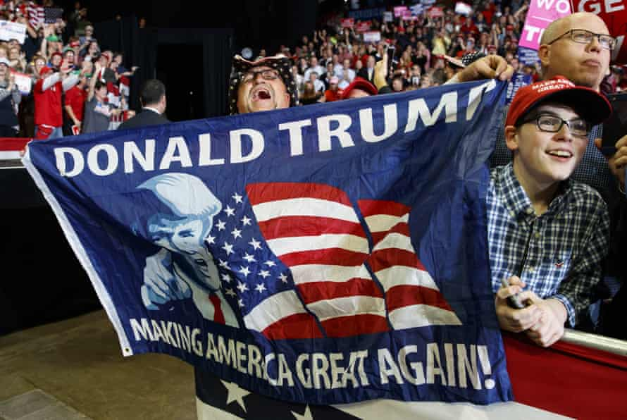 Supporters of Donald Trump cheer as the president arrives to speak at a rally in Cape Girardeau, Missouri, on the eve of the midterm elections.