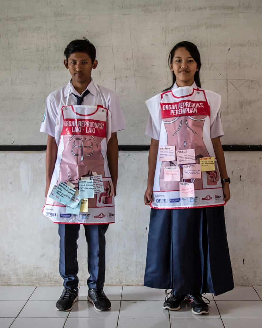 A boy and girl taking part in sex education lessons at SMPN 22 school in Semarang