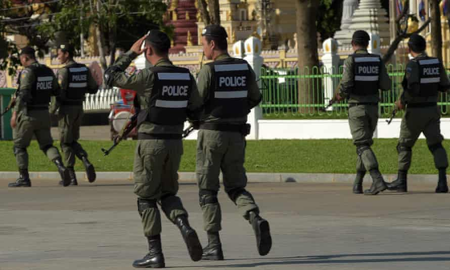 Cambodian police patrol Phnom Penh during the supreme court hearing.